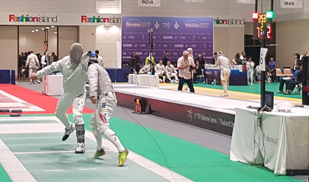 Radu fencing in the Men's Sabre Teams competition